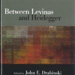Between Levinas and Heidegger cover